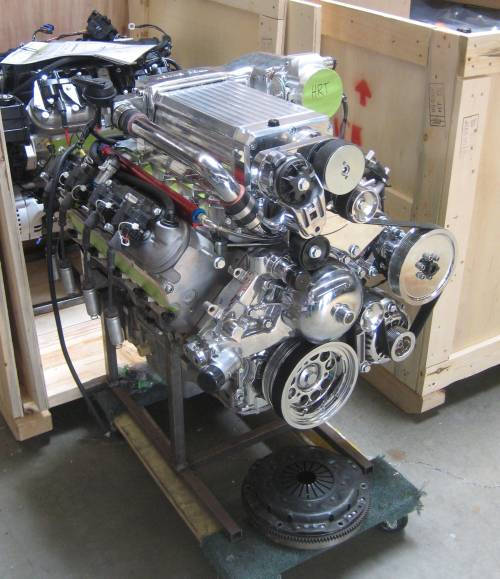 chevy ls series engines ls1 ls2 ls6 ls7 lsx camarotech com ls engine installed a kenne bell supercharger pumping out 900 hp approx