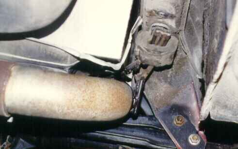 Use of the stock heat shield protecting the gas tank from the muffler